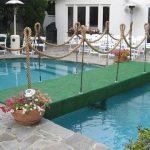 Bridge-Pool-Cover-with-Green-Astroturf-Railings