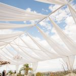 Close-up-of-Open-Tent-Top-with-White-Sheer-Drapery