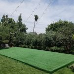 Green-Astroturf-Stage-Pool-Cover-with-String-Lights-3