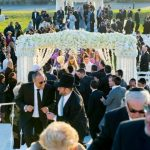 Guests-exiting-after-wedding-ceremony-from-stage-to-resort-1-1