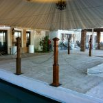 Partial-Pool-Cover-with-White-Carpet-Wood-Railings