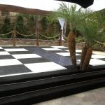 Stage-Pool-Cover-with-Black-White-Checkered-Dance-Floor
