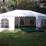 Tent-Built-on-Top-of-Pool-Cover-with-Green-Astroturf